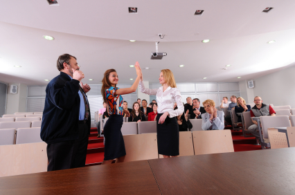 Employees High Fiving when getting awards